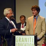 Photo of Excel Award recipient receiving award from sponsor