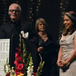 Photo of Excel Award recipient receiving award from sponsor