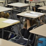 Photo of Hunter High students crouching under desks