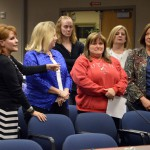 Photo of office professionals being recognized at board meeting
