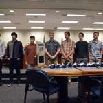Photo of student athletes being recognized at board meeting