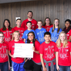 Photo of Eisenhower students holding large check