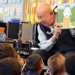 Photo of volunteer reading to Redwood Elementary students