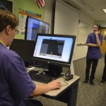 Photo of GTI students explaining game production
