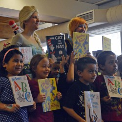 Photo of Hillsdale Elementary students posing with donated books