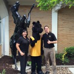 Photo of West Lake staff posing with mascot