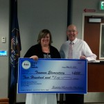 Photo of principal receiving attendance challenge check for school