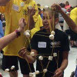 Photo of students building marshmallow tower