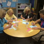 Photo of Kearns Network principals solving math problems