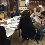 Photo of Taylorsville High Warrior Ledger staff reading newspapers
