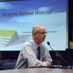Photo of administrator giving a report at board meeting