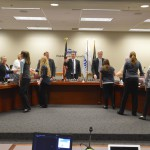 Photo of students shaking hands with members of the board of education
