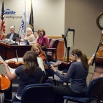 Photo of student quintet performing during board meeting