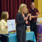 Photo of UESP employees presenting check to Jackling Elementary