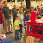 Photo of young students at GTI woodworking show