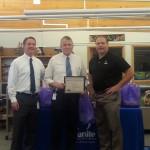 Photo of employee receiving district Wellness award