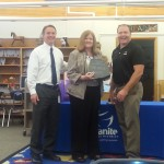 Photo of employee receiving district Wellness award