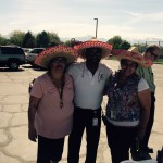 Photo of West Lake parent volunteers wearing hats