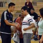 Photo of Hunter High student shaking hands with Real Monarchs player