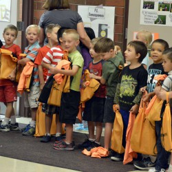 Photo of Jackling students receiving donated backpacks
