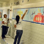 Photo of volunteers painting murals at South Kearns Elementary