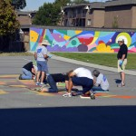 Photo of volunteers painting sidewalk at Granger Elementary