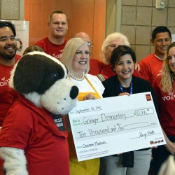 Photo of Granger Elementary principal receiving large check
