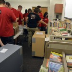 Photo of volunteers sorting books at Granger Elementary
