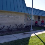 Photo of volunteers improving grounds at Moss Elementary