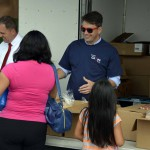 Photo of parents receiving food from Food Pantry