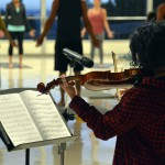 Photo of Churchill Jr High student playing violin