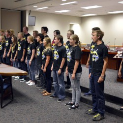 Photo of Taylorsville High madrigals performing at board meeting