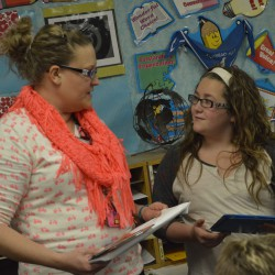 Photo of Bennion Elementary teacher speaking to student