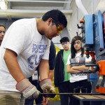 Photo of Granger High student working with large machine