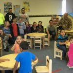 Photo of Kearns Jr High students with preschool furniture