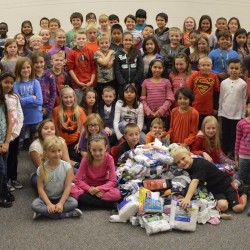Photo of Elk Run students with pile of donated socks