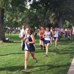 Photo of cross country athletes running