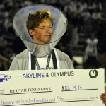 Photo of Olympus High student with 'cone of shame' holding large check