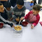 Photo of Twin Peaks students using chopsticks