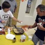 Photo of a parent sampling food at Twin Peaks Elementary