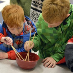 Photo of Twin Peaks students using chopsticks
