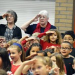 Photo of Orchard Elementary students and staff saluting veterans