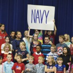 Photo of Orchard Elementary students holding sign with text 'Navy'