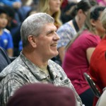 Photo of veteran watching Orchard Elementary program