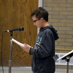 Photo of Orchard Elementary student reciting essay