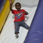 Photo of student sliding down inflatable slide