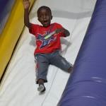 Photo of student sliding down inflatable slide