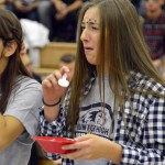 Photo of two students cringing after eating dog food