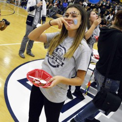 Photo of students trying to eat dog food