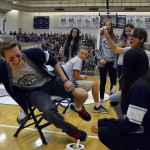 Photo of student getting leg waxed during assembly